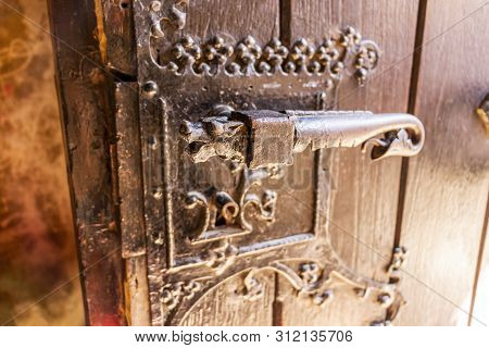 Decorated Door Lock At The Corvin Castle, Also Known As Hunyadi Castle Or Hunedoara Castle, Hunedoar