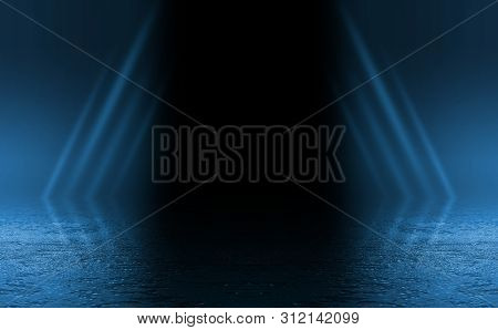 Empty Background Scene. Dark Reflection Of The Street On The Wet Asphalt. Rays Of Neon Light In The