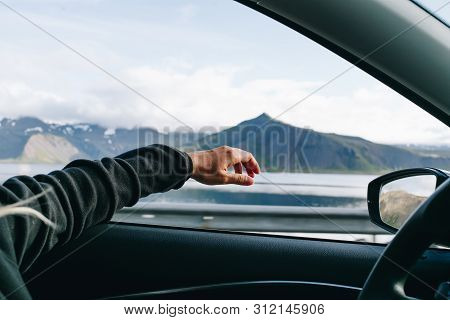 Adventure Mood, Wanderlust Nomad Travel Blogger Lifestyle Concept. Woman Holds Out Hand Out Of Windo