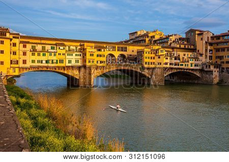 Florence, Italy - April, 2018:  Golden Hour At The Ponte Vecchio A Medieval Stone Closed-spandrel Se