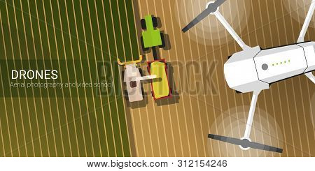 Drone Flying Over The Field And Harvesting. Aerial Drone Taking Photography And Video.