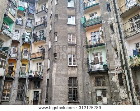 Old Gray Soviet House, Crumbling Walls, On The Balconies Of Peoples Things, Warehouse. The Color Of
