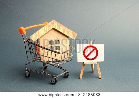 House In The Shopping Cart And The Sign Of The Ban No. Inaccessible And Expensive Housing. Seizure A
