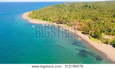 Lagoon And Beach With Boats On Camiguin Island, Aerial View. Tropical Island With Palm Trees And Vol