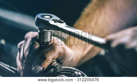 Auto Mechanic Working On Car Engine In Mechanics Garage. Repair Service.