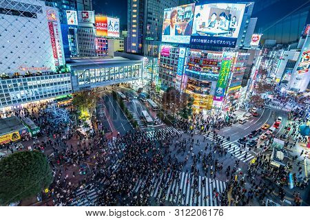 Shibuya, Tokyo, Japan - December 24, 2018: Top View Of Crowd People Pedestrians Walking Cross Zebra