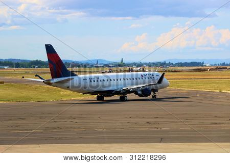 June 29, 2019 In Eugene, Or:  Delta Airlines Embraer 175 Aircraft Taxiing For Departure Taken At The