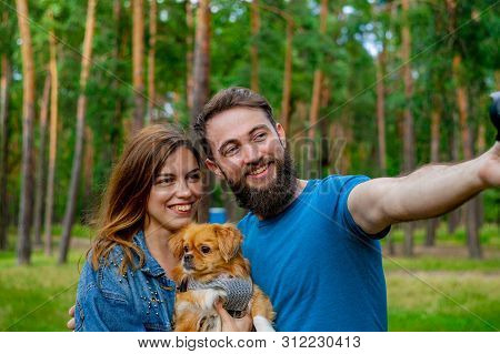 Taking Selfie. Beautiful Good-appealing Smiling Happy Contended Young-adult Couple Spending Time On