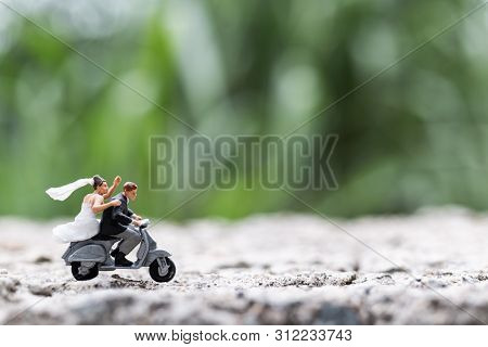 Miniature People : Couple Riding The Motorcycle