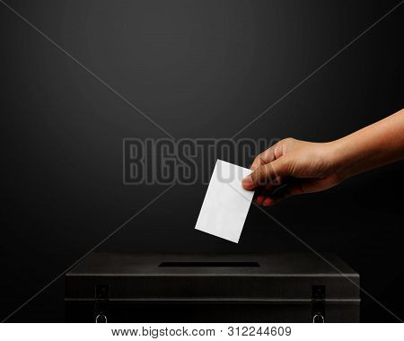 Hand Holding Card For Election Vote.vote Is Very Important For Our Nation.everyone Do The Vote.