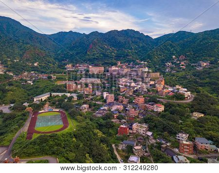 Aerial View Of Buildings In Jiufen Village On Mountain Hill With Green Natural Forest Trees In Rural