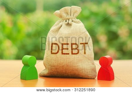 A Bag With The Inscription Debt Stands Between Two Figures Of People. Unclosed Obligations Between T