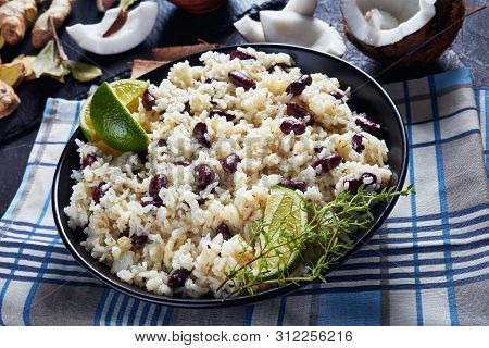 Close-up Of Jamaican Rice And Red Beans Cooked With Coconut Milk Seasoned With Garlic, Onions And Cr