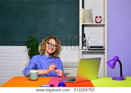 University student going to college. Female teacher near blackboard. Young smiling female student studying in school. Happy student or woman teacher. Beautiful teacher in classroom. Exam in college. poster