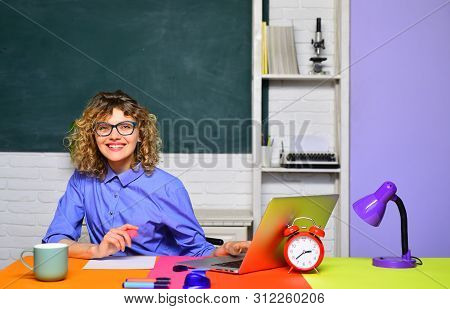 Young Female Teacher. Funny Female Teacher In Classroom. Student In College. World Teachers Day. Stu