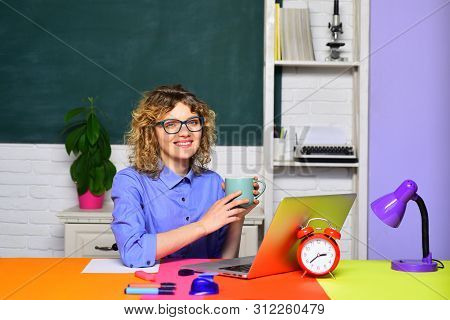 Smiling Teacher In Classroom. Funny Female Teacher In Classroom. Student In College. World Teachers