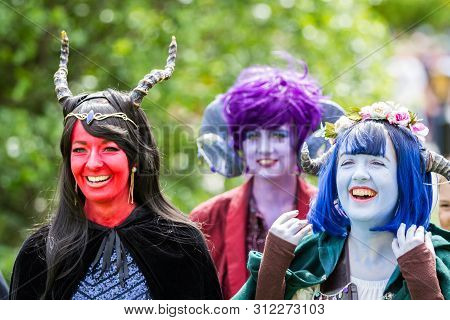 Nec, Birmingham, Uk - June 1, 2019. Cosplayers Dressed As Colourful Critters With Face Paint At A Co