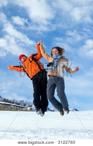 Couple Jumping Over Blue Sky In Winter Mountains Tien Shan (Series Sport, Extreme, Mountains, Horses