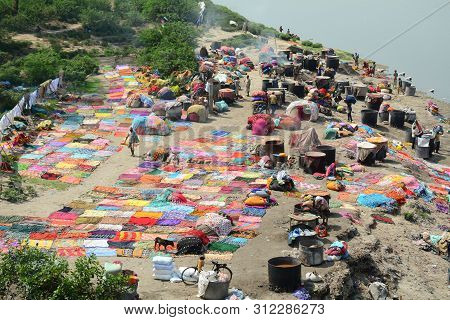 Agra, India - Jul 13, 2015. People Washing And Drying Cloth On The Sandy Banks Of Yamuna River, Agra