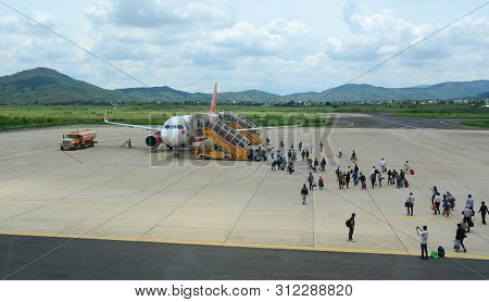 Dalat, Vietnam - May 20, 2016. An Airplane With Passengers At The Lien Khuong Airport In Dalat, Viet