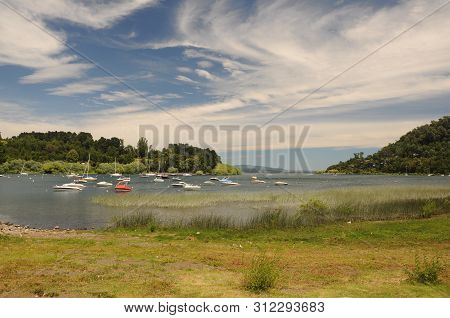 Small Boats In Port On The Villarica Lake In Pucon. Dramatic Sky With Clouds. Summer Mood On Small L