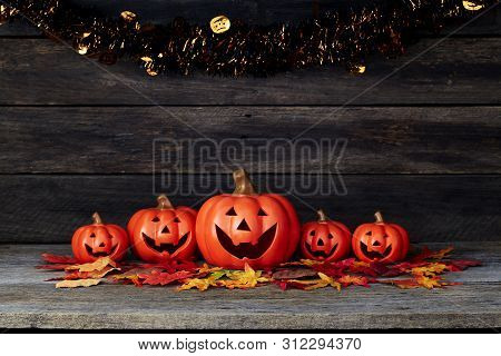 Halloween Pumpkin Lantern. Trick Or Treat On A Wooden Table
