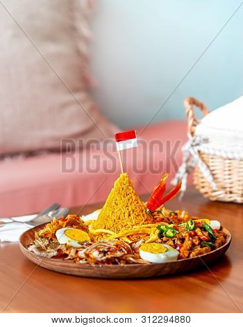 Cone Shaped Yellow Padang Rice Called Nasi Tumpeng With Indonesian National Flag On Top Of For Indep