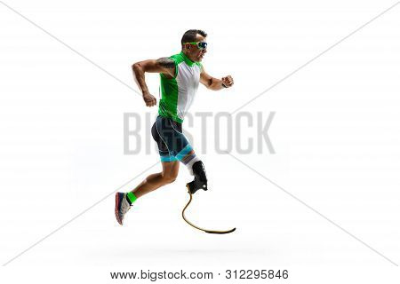 Athlete With Disabilities Or Amputee Isolated On White Studio Background. Professional Male Runner W