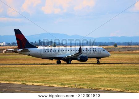 June 30, 2019 In Eugene, Or: Delta Airlines Embraer 175 Aircraft  Taxing For Takeoff Taken At The Eu