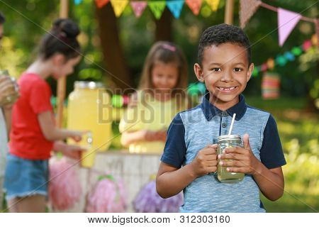 Cute Little African-american Boy With Natural Lemonade In Park, Space For Text. Summer Refreshing Dr