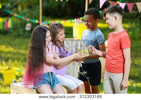Cute Little Children With Natural Lemonade In Park. Summer Refreshing Drink