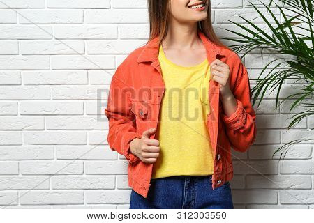 Young Woman Wearing Blank T-shirt Near White Brick Wall, Closeup. Mockup For Design