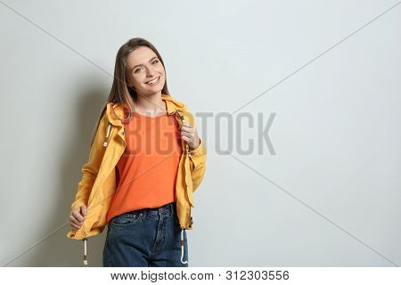 Young Woman Wearing Blank T-shirt On Light Background. Mockup For Design