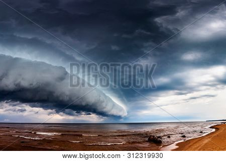 Huge Dramatic Wide Dark Storm Clouds over sea. Panoramic montage from 19 images