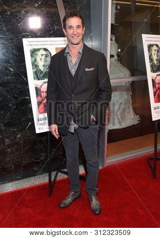 LOS ANGELES - JUL 18:  Noah Wyle arrives for the 'David Crosby: Remember My Name' Los Angeles Premiere on July 18, 2019 in Hollywood, CA