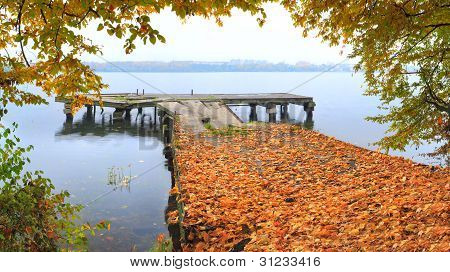 Beautiful Autumn Landscape With Lake And Old Pier