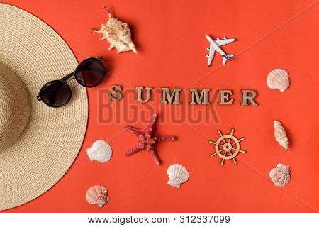 Word Summer From Wooden Letters. Seashells, Plane, Part Of A Hat, Sunglass And Steering Wheel. Live