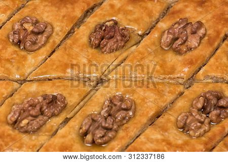 Turkish Baklava With Walnuts. Close-up. Traditional Oriental Dessert
