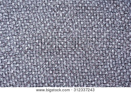 Gray And White Wool Fabric With A Pattern Of Teeth. Background