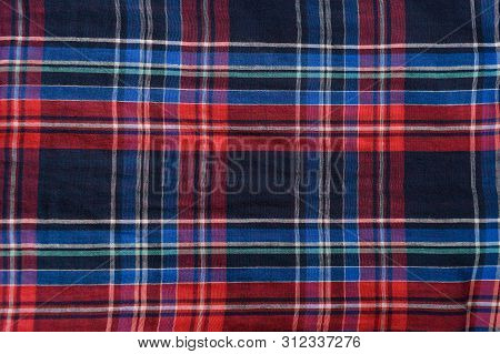 Blue With Red Checkered Seamless Fabric. Textural Background