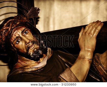 a figure of Jesus Christ carrying the holy cross