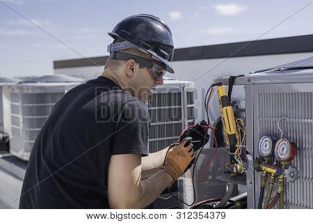 Hvac Tech Reading Refrigerant Gauges And Meter