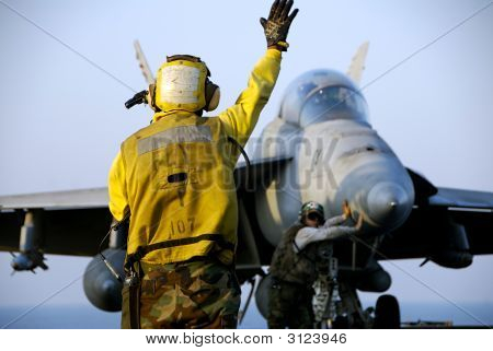 F-18 Hornet And Sailors