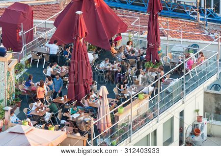 Istanbul, Turkey - August 27, 2013: View From Above On Roof Top Restaurant With Patrons Having Meals