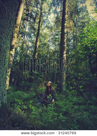 girl sitting in forest