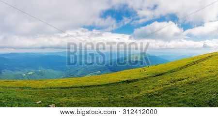 Beautiful Panorama Of A Summer Landscape. Grassy Hills And Distant Ridges, Amazing Scenery In Mounta