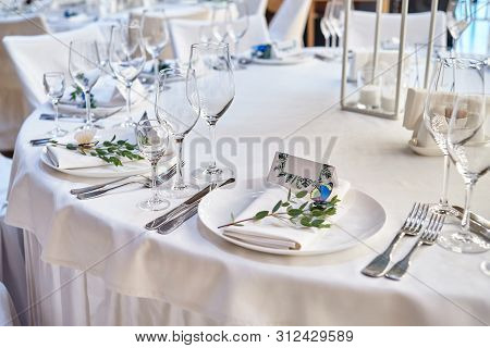 Table Setting With Blank Guest Card On Empty White Plate And Cutlery On Table, Copy Space. Menu Mock