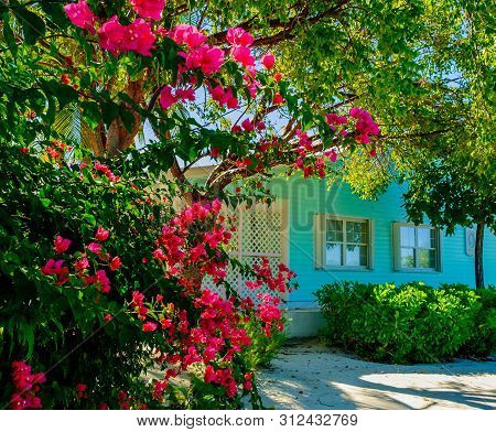 Little Cayman, Cayman Islands, Nov 2018, Close Up Of A Turquoise Caribbean-style House And Its Front