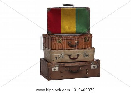 Guinea, Guinean Travel Concept. Group Of Vintage Suitcases Isolated On White Background