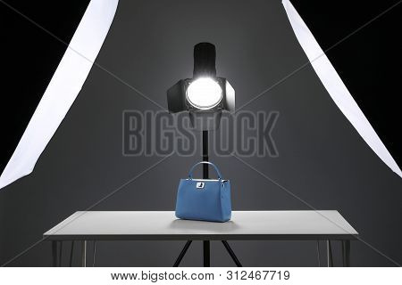 Professional Photography Equipment Prepared For Shooting Stylish Bag In Studio